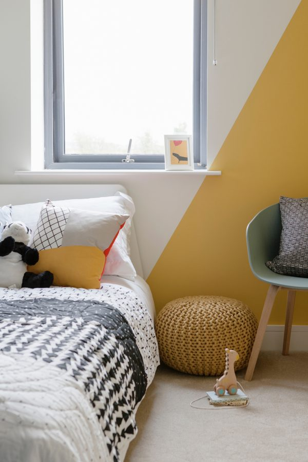 Child's bedroom with cheerful grey and yellow decor