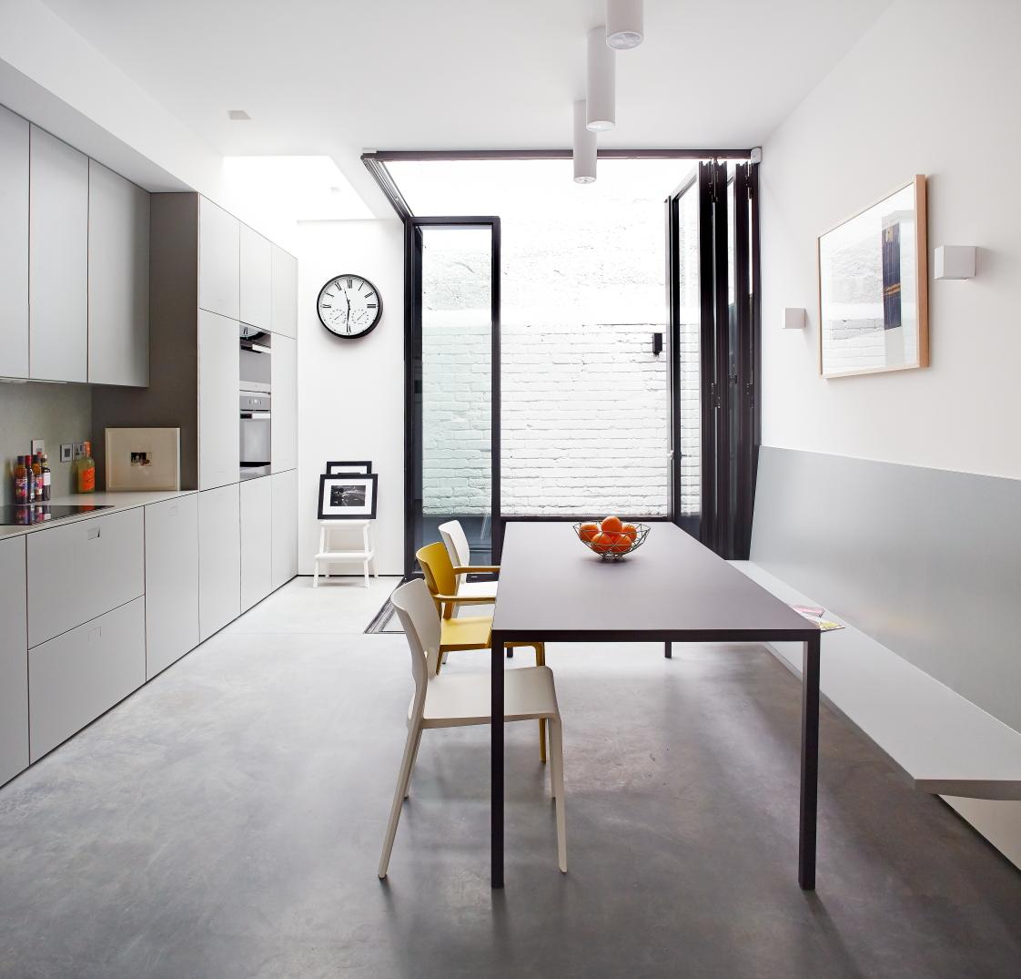 Large folding glass door in contemporary minimalist kitchen