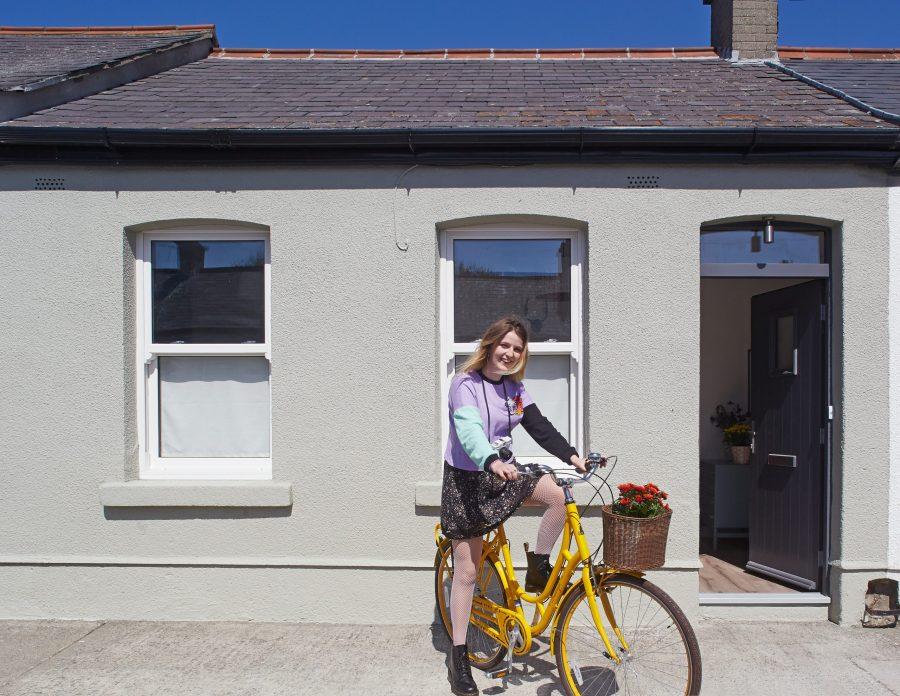 Julie cycling her bike