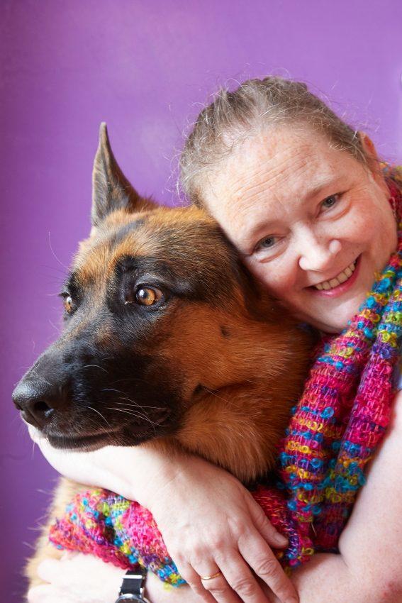 Handweaver Liz Christ with her dog Layla