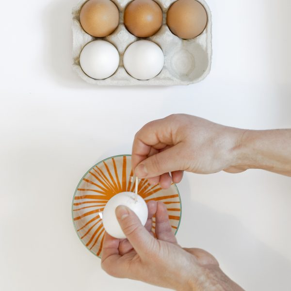 insterting the cocktail stick into the egg hole