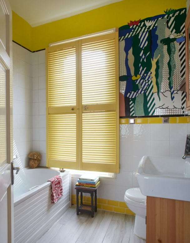 bright yellow and white wall colours in bathroom