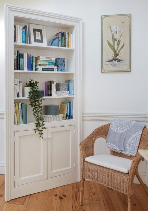 A close up of the book shelving unit which is also amagic door