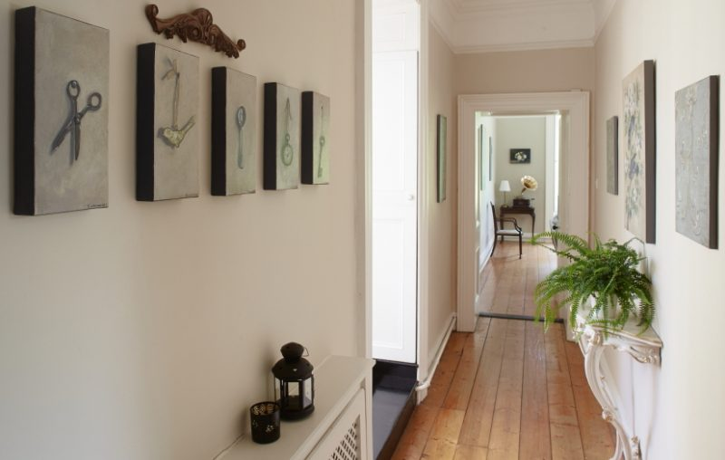 Jane's artwork in the hall of her house