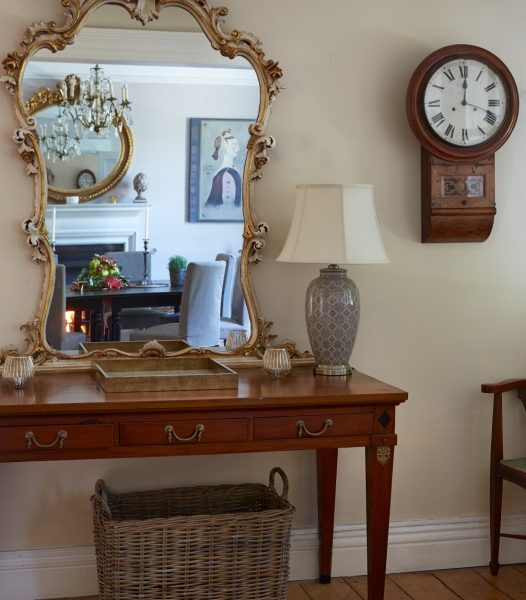 mirror and table at the en